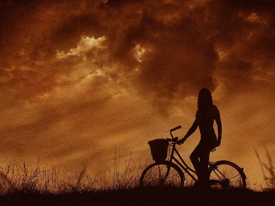 Also an easy image to do in post-production. Exposure one captured the lovely Rachel sitting astride of her charming bicycle at sunset. Exposure two of the clouds was shot on a different day then layered to overlap the existing sky. The bottom part of the sky image was gently removed with a soft eraser tool in Photoshop. Both images were flattened together then a warm tone applied.