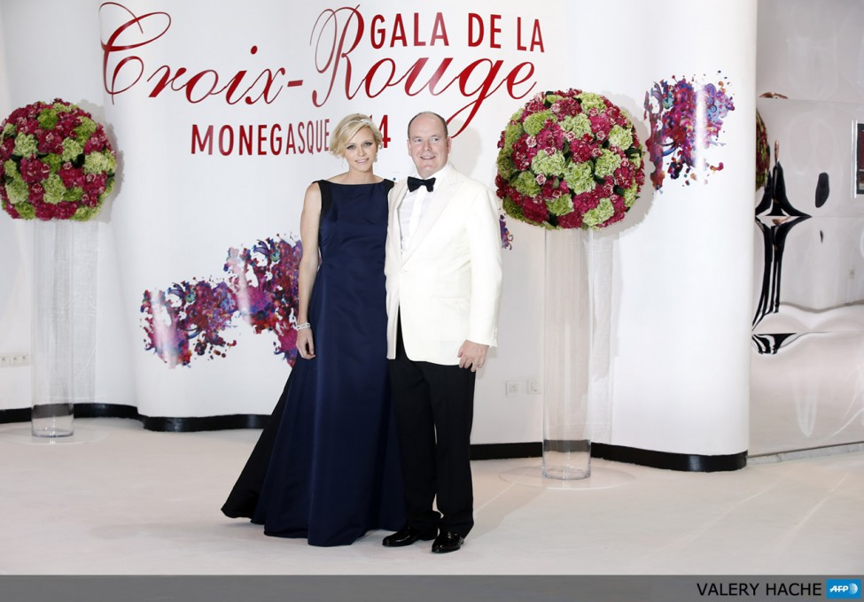 Prince Albert II of Monaco (R) and Princess Charlene arrive to attend the 66th annual Red Cross Gala, on August 1, 2014, in Monaco. Created in 1948, the gala is an annual charity event held in Monaco by the Princely Family during the summer. AFP PHOTO / VALERY HACHE