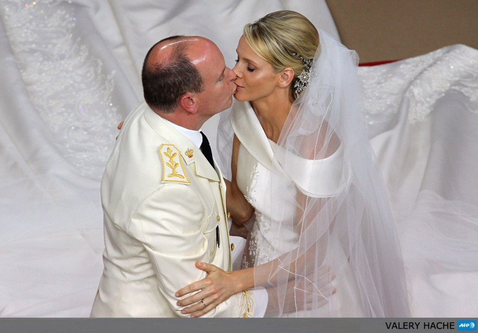 Prince Albert II of Monaco kisses Princess Charlene of Monaco during their religious wedding at the Main Courtyard of the Prince's Palace on July 2, 2011 in Monaco.