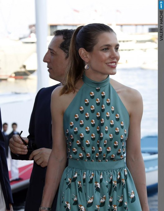 Charlotte Casiraghi (R) and humorist Gad Elmaleh are pictured during the inauguration of the new Yacht Club of Monaco, on June 20, 2014 in Monaco.