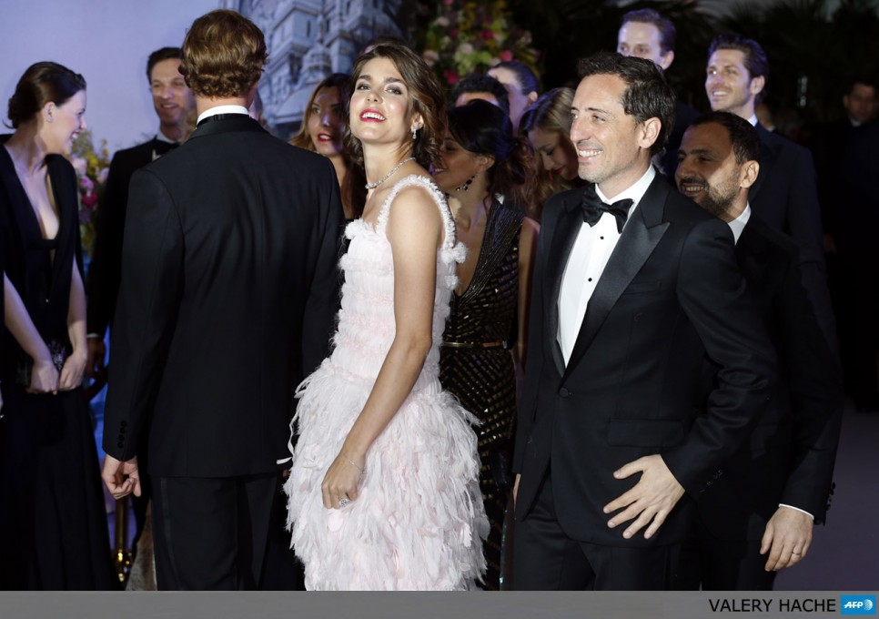 "Charlotte Casiraghi and French humorist Gad Elmaleh (R), arrive for the annual Rose Ball at the Monte-Carlo Sporting Club in Monaco, on March 23, 2013. The Rose Ball is one of the major charity events in Monaco. Created in 1954, it benefits the Princess Grace Foundation. Directed by German Couturier Karl Lagerfeld, this year's event named ""La Belle Epoque"" (Beautiful Era), was celebrated in honor of the Societe des bains de mer (SBM),  a prominent player in Monaco's tourism industry."
