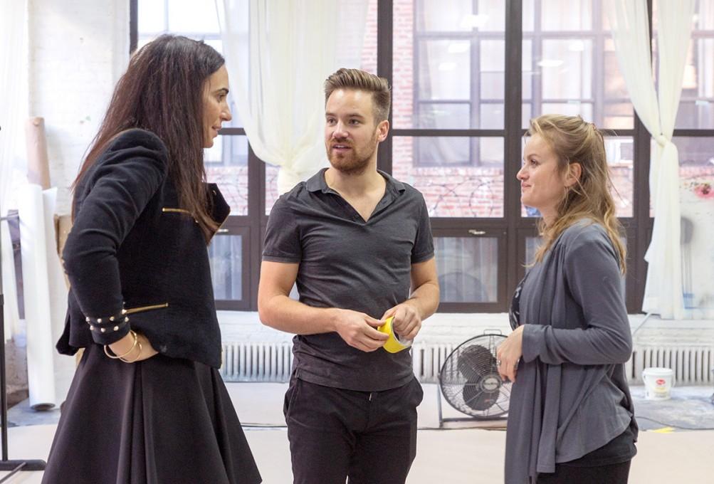 Felix talking with the client Gloriana Bonillo-Valera and production assistant