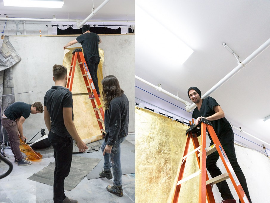 The crew working to hang the background for the first shot.