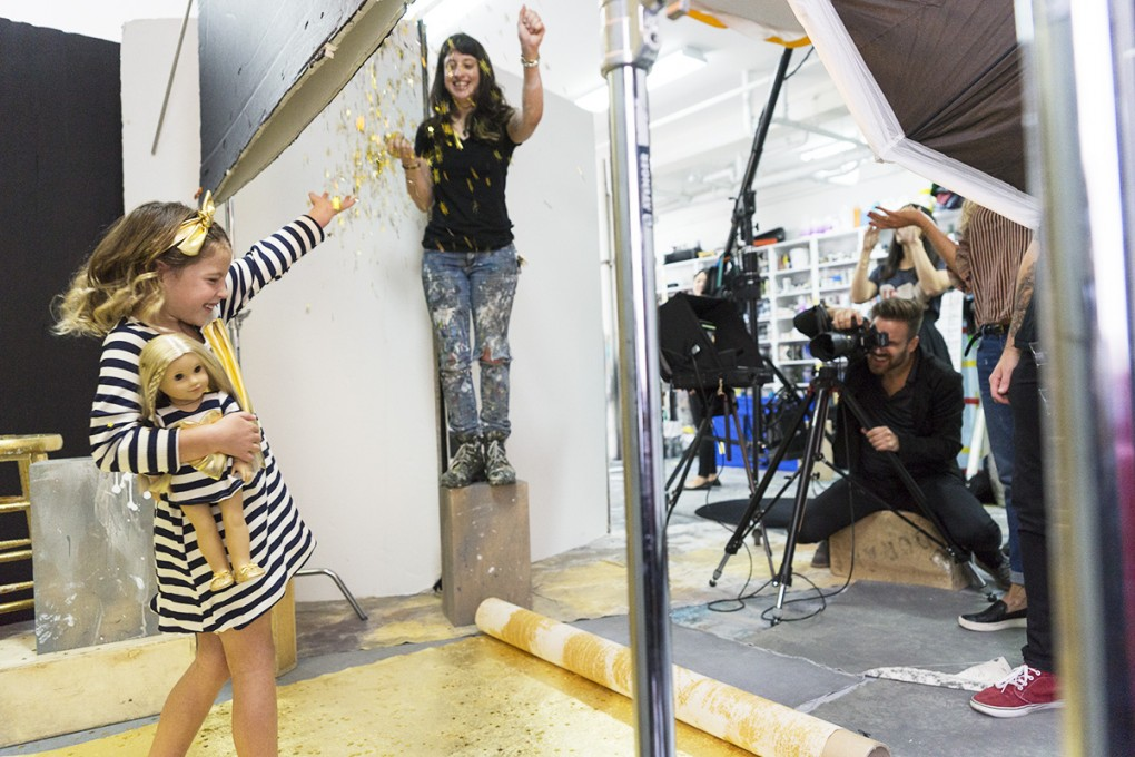The first model with gold glitter raining down and Felix behind the camera capturing it all.