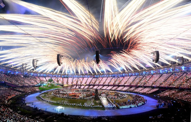 LONDON, ENGLAND - JULY 27:  Fireworks burst above the stadium during the Opening Ceremony of the London 2012 Olympic Games at the Olympic Stadium on July 27, 2012 in London, England.  (Photo by Michael Regan/Getty Images)