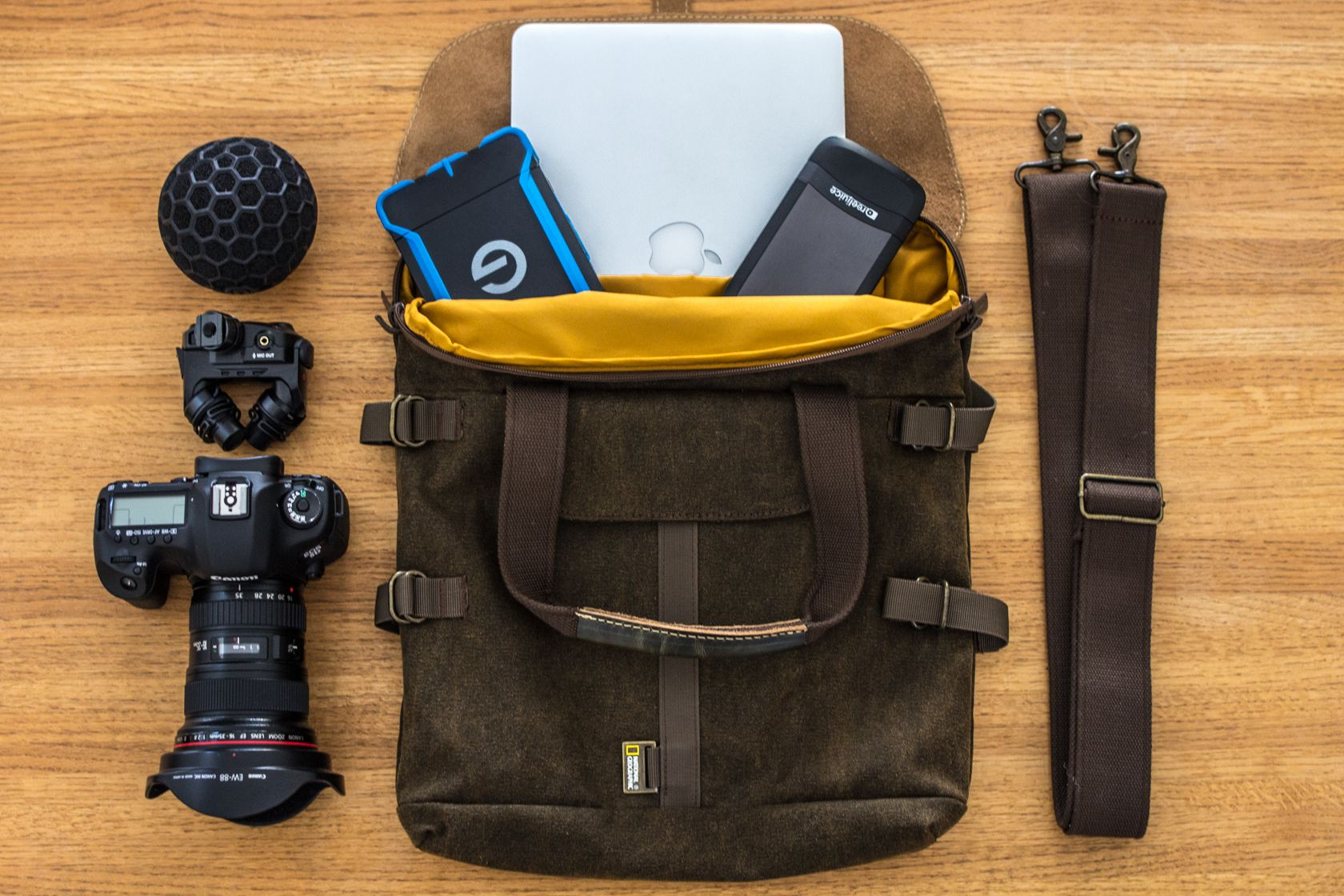 {Pictured: Apple Macbook Pro, G-technology Rugged 1tb drive, Lynktec Reel Juice portable charger, Canon 5dmiii, Rode Stereo Mic X, Nat Geo/ Manfrotto tote bag}