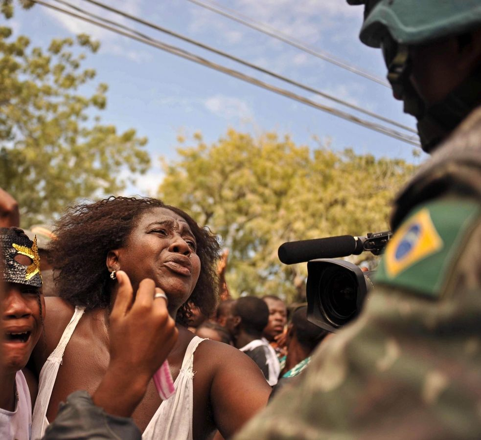 A mother pleads with a Brazilian UN peacekeeper. Neither her or her daughter had eaten for three days.