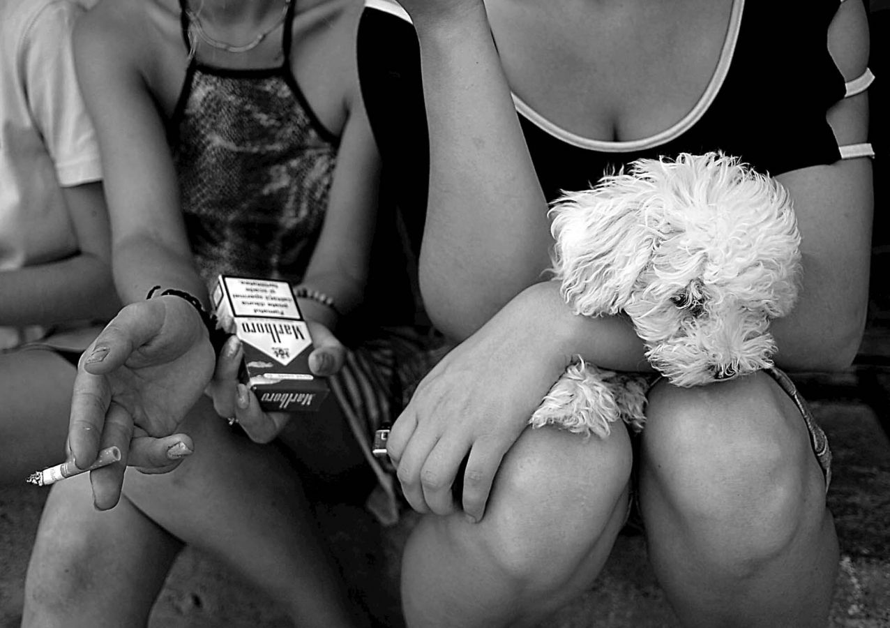 Two fifteen-year-old girls relaxing at a rescue center in Romania. Both have been trafficked into the sex trade.