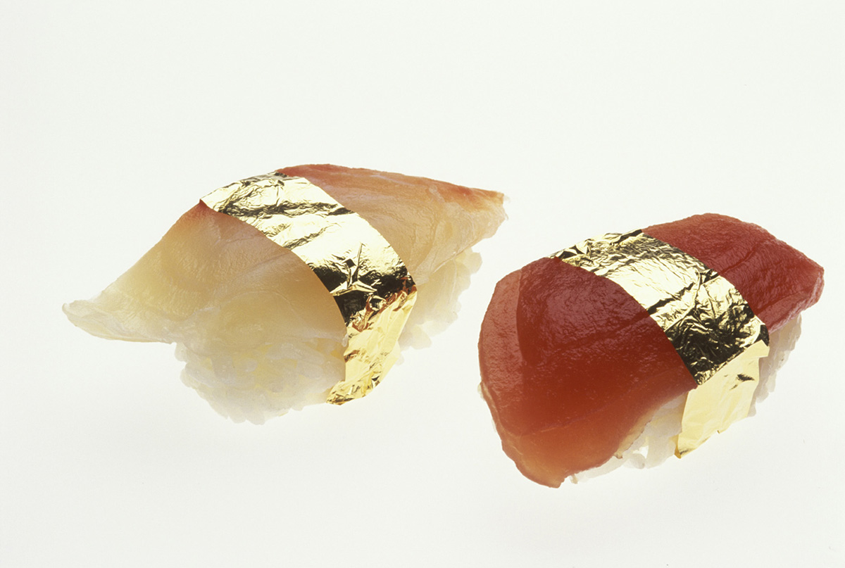 Japanese sushi warpped with gold leaf. A fad that arose in Japan during the booming economy of the 1980s — gold-leaf sushi — became an over-priced speciality of some restaurants. Since gold is inert, in these quantities it has no biological effect on the human body, good or bad.