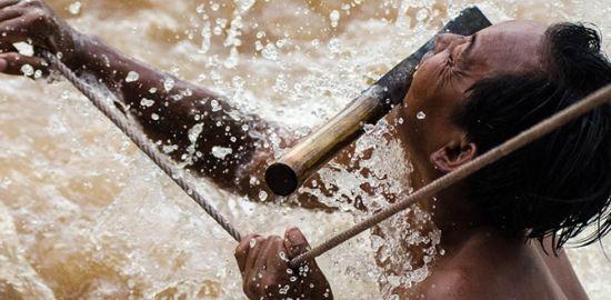 Waterfall Fisherman