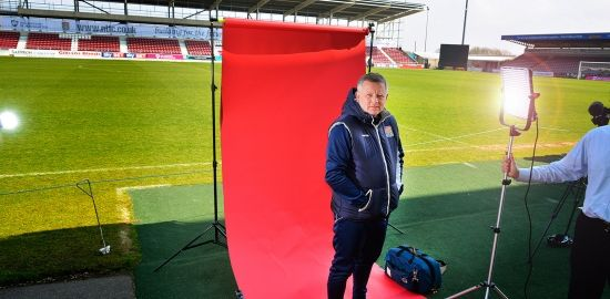 In the spotlight......Chris Wilder, Manager of Northampton Town FC at Sixfields Stadium with the new stand in the background, 14th April, 2016. Photo for Daily Telegraph Sport by John Robertson.