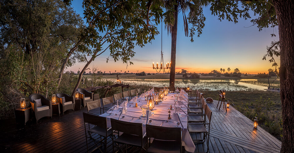 Deck dining at Macatoo Camp. African Horseback Safaris. Okavango Delta. Botswana